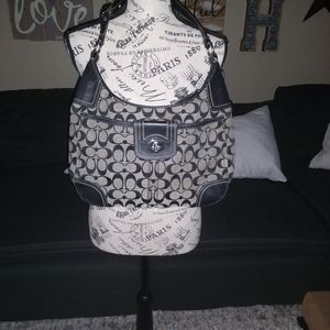 Black and grey authentic Coach purse.